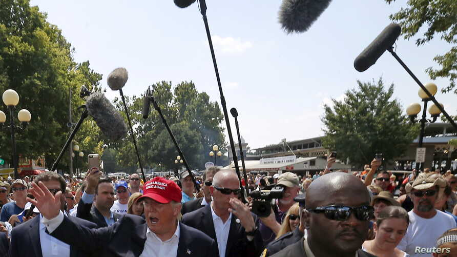 U.S. Republican presidential candidate Donald Trump greets attendees at the Iowa State Fair during a campaign stop in Des Moines, Iowa, United States, Aug. 15, 2015.