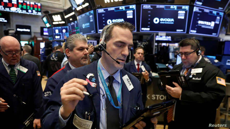 Traders work on the floor of the New York Stock Exchange shortly after the opening bell in New York, March 19, 2018.