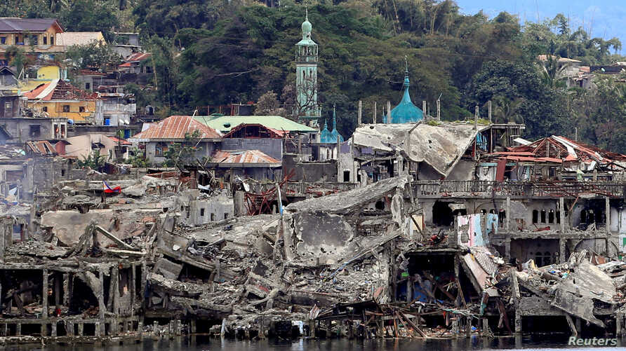 Damaged buildings are seen inside a war-torn area in Marawi City, southern Philippines October 24, 2017, after the Philippines announced on Monday the end of five months of military operations in a southern city held by pro-Islamic State rebels.