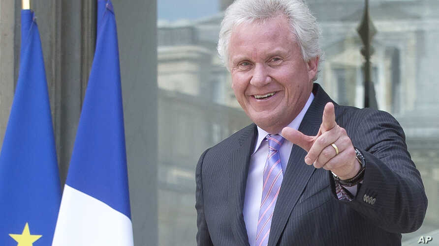 File - General Electric CEO Jeffrey Immelt gestures as he leaves the Elysee Palace after a meeting with French President Francois Hollande, June 2014.