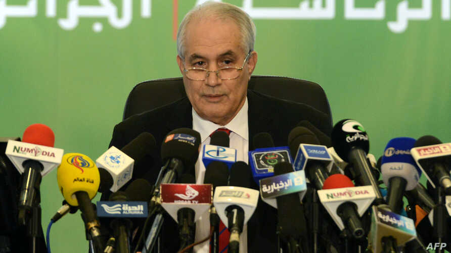 Algerian Interior Minister Tayeb Belaiz announces the results of the presidential election during a press conference in Algiers, April 18, 2014.