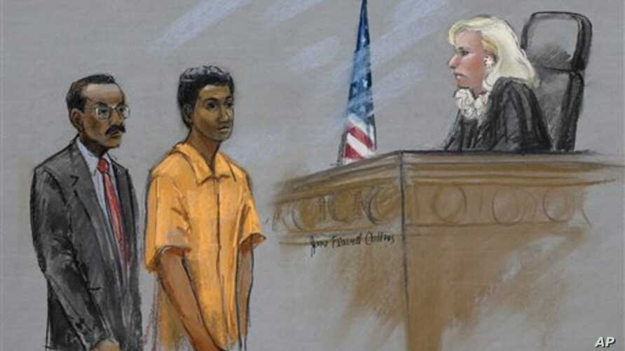 Courtroom sketch shows defendant Robel Phillipos, center, stands with defense attorney Derege Demissie before Federal Magistrate Marianne Bowler, U.S. District Court, Boston, May 6, 2013.
