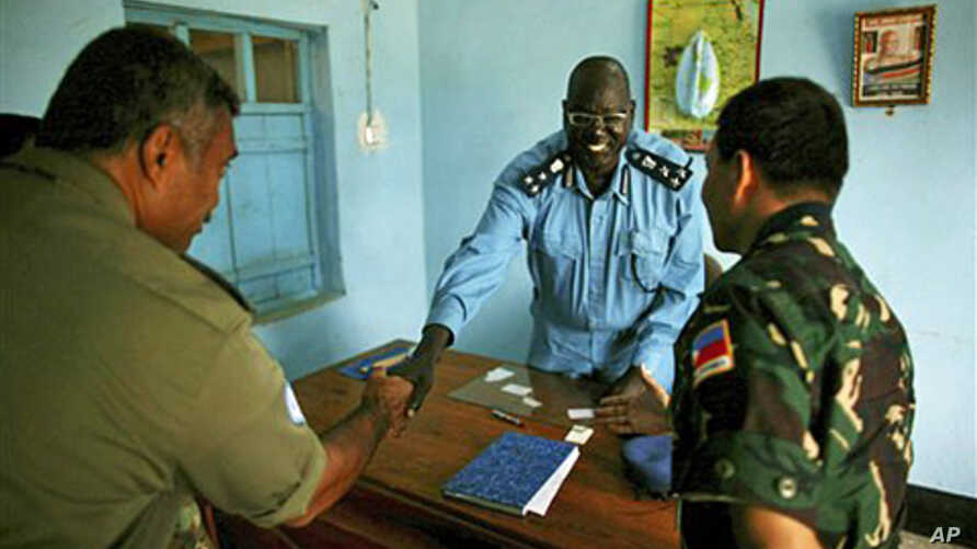 United Nation's military observers greet the Director of Police, Brig. Gen. William Chulo, in  Renk, southern Sudan, 15 Sep 2010