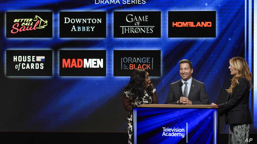 """Bruce Rosenblum, chairman and CEO, Academy of Television Arts & Sciences, center, announces """"Orange is the New Black"""" as a nominee for outstanding drama series at the 67th Primetime Emmy Nominations announcements at the Pacific Design Center, July 16"""