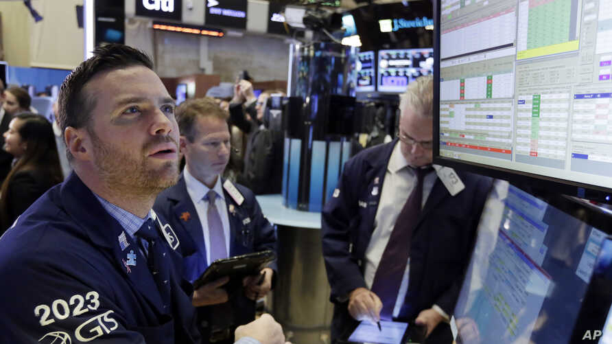 Specialist Frank Masiello, left, works at his post on the floor of the New York Stock Exchange, Monday, Nov. 7, 2016. Stocks are opening sharply higher on Wall Street after the F.B.I. said newly discovered emails didn't warrant any action against pre...
