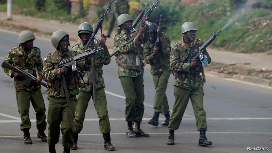 """FILE - Anti-riot police fire live bullets into the air to disperse opposition protesters in Nairobi, Kenya, Nov. 17, 2017. Thursday, a judge in Kenya has found five top police commanders """"culpable"""" for the death of a six-month-old during post-electio"""