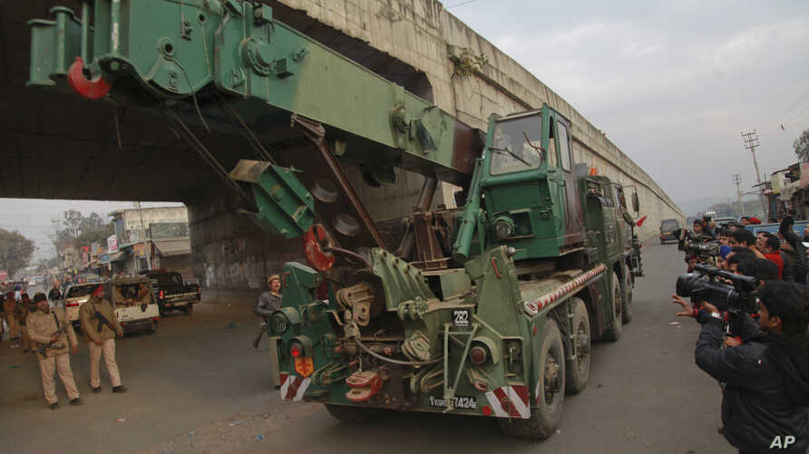 An Indian army truck carrying military equipment moves towards the Indian air force base in Pathankot, India, Monday, Jan. 4, 2016.