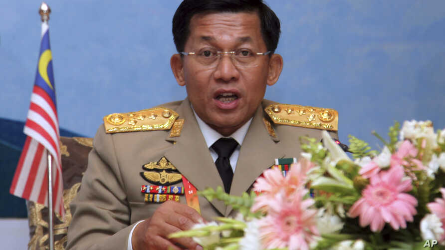 FILE - General Min Aung Hlaing talks to journalists at a meeting of ASEAN defense chiefs in Naypyitaw, Myanmar, March 5, 2014.