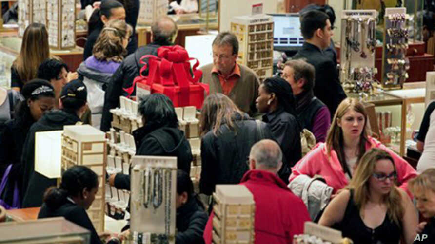 Macy's aisles are crowded with shoppers on Black Friday - called that because the surge of shoppers could take retailers into profitability, Manhattan, 26 Nov. 2010