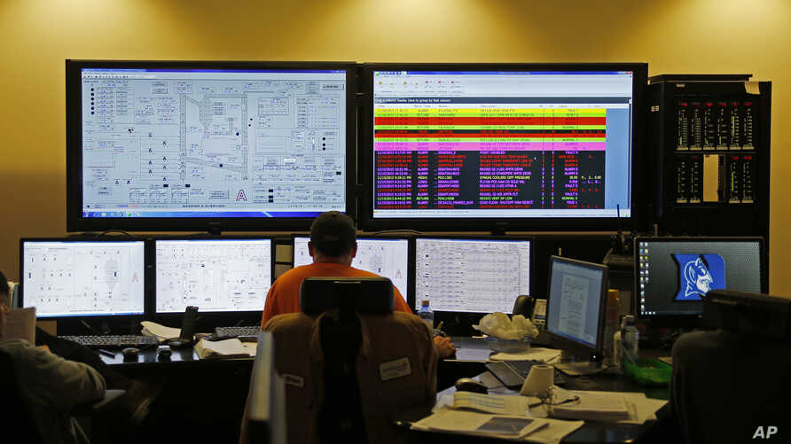 In this Nov. 16, 2015 photo, engineers in a control room monitor the status of the Mississippi Power Co. carbon capture power plant in DeKalb, Mississippi.