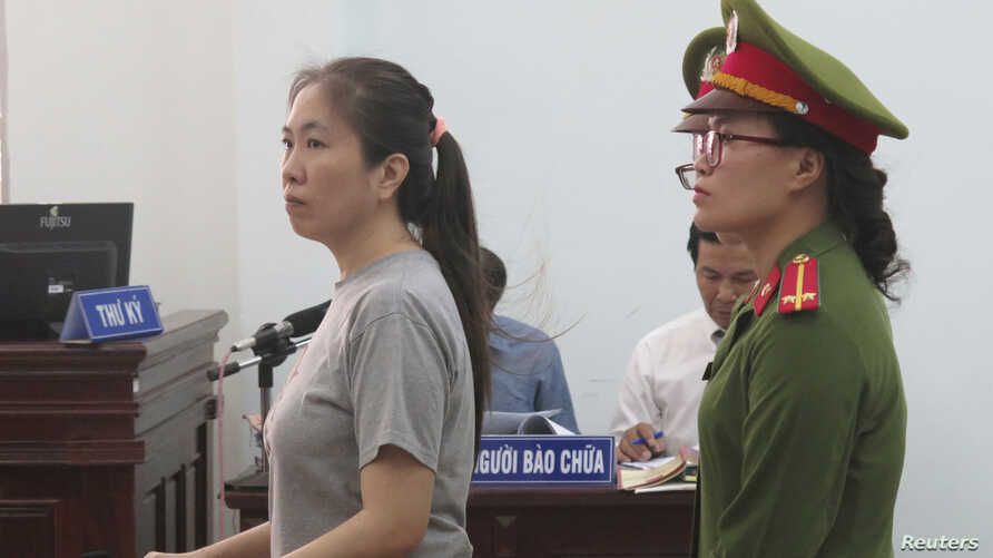 Prominent blogger Nguyen Ngoc Nhu Quynh, left, stands trial in the south central province of Khanh Hoa, Vietnam, June 29, 2017. She was accused of distorting government policies and defaming the Communist regime on her Facebook posts.