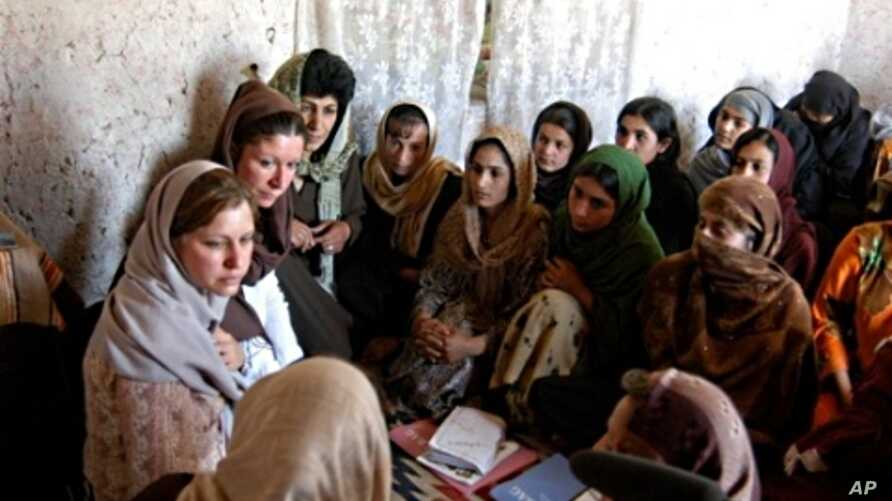 Susan Retik Ger and Patti Quigley visit a literacy class in Afghanistan.