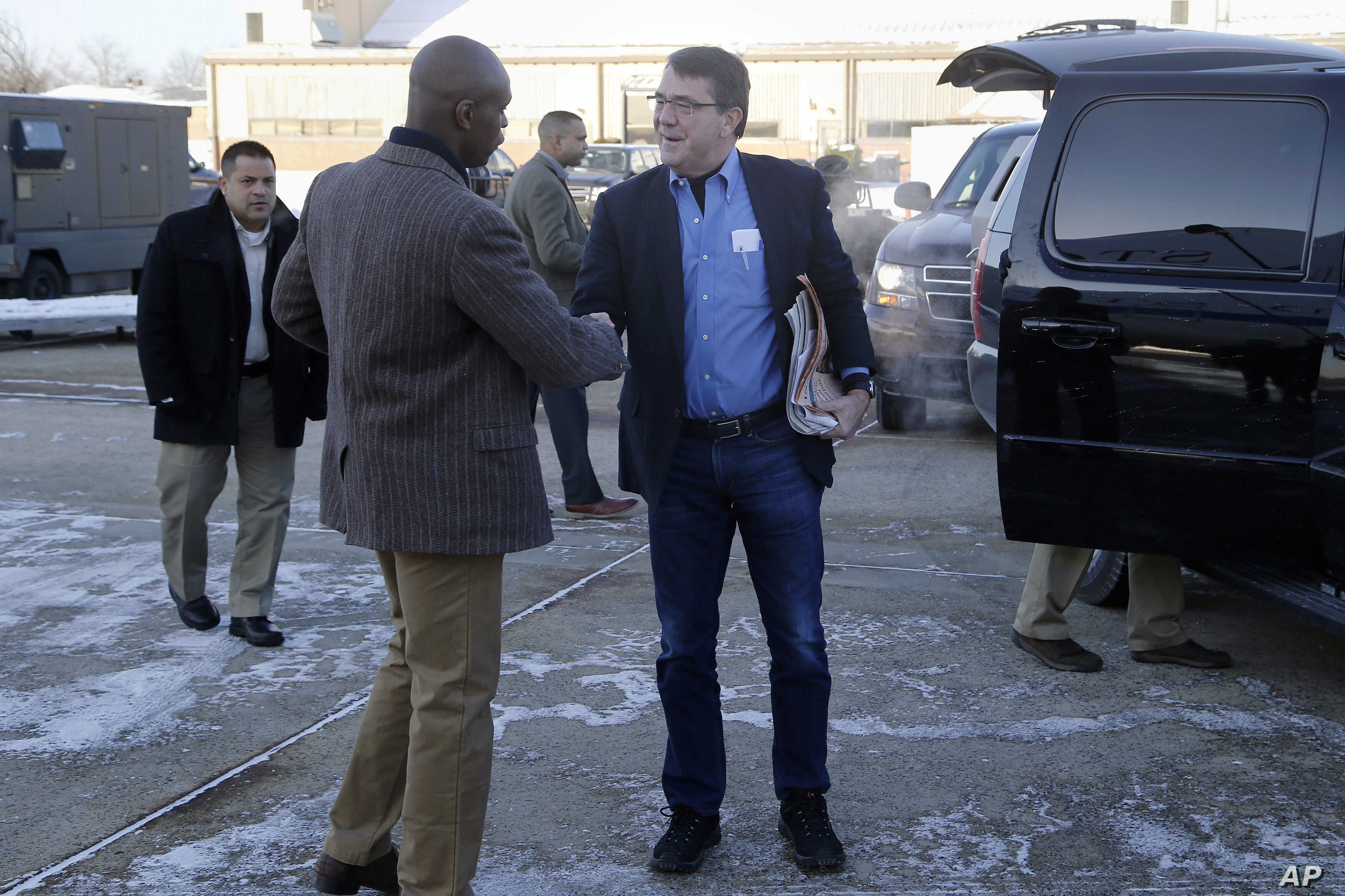 Pentagon Military Aide Investigation: FILE - In this Feb. 20, 2015, file photo, U.S. Secretary of Defense Ash Carter, center, is greeted by Senior Military Assistant U.S. Army Maj. Gen. Ron Lewis as they arrive at Andrews Air Force Base, Md., to trav