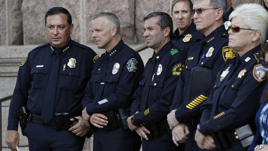 "Austin Police Chief Brian Manley, second from left,  and other Texas police officers  take part in a public safety event where they spoke against a proposed ""bathroom bill,"" July 25, 2017, in Austin, Texas."