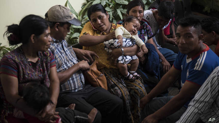 "Families wait to be reunited with their children who were separated from them by U.S. immigration authorities, at the shelter ""Nuestras Raíces"" in Guatemala City, Tuesday, Aug. 7, 2018."