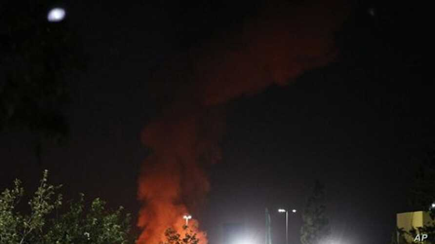 A plume of smoke and fire is seen after an airstrike in Tripoli, Libya, June 14, 2011.