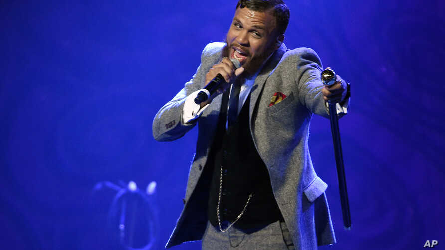 FILE - Jidenna performs during EBONY magazine's 30th Annual Power 100 Gala in Beverly Hills, California, Dec. 2, 2015.