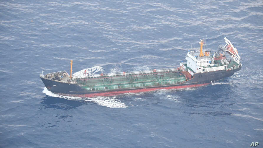 This May 19, 2018 photo released by Japan's Ministry of Defense shows North Korean-flagged tanker Ji Song 6 in the East China Sea. Japan's foreign ministry says a Japanese navy surveillance aircraft has spotted a suspected Chinese-flagged ship appare