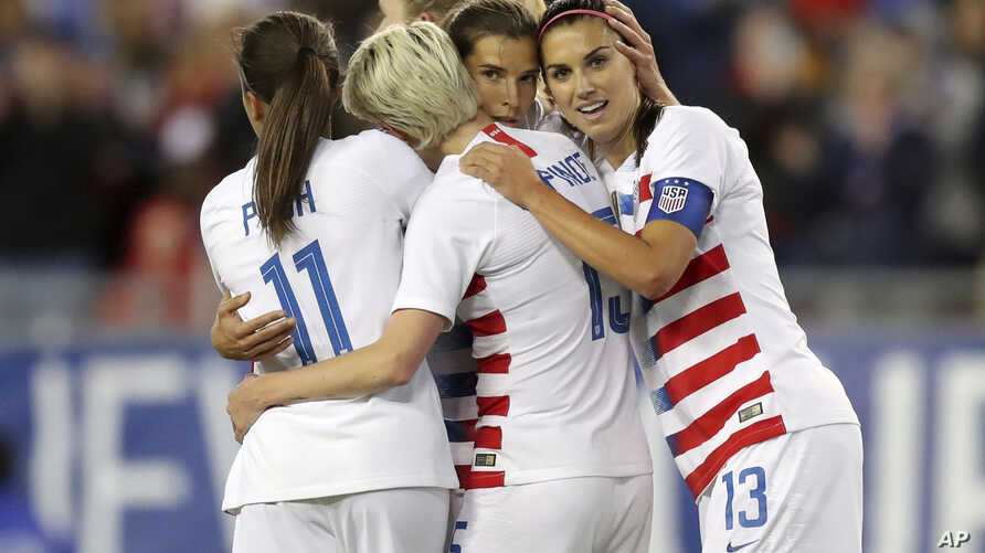 United States' Tobin Heath, second from right, is congratulated on her goal by Mallory Pugh (11), Megan Rapinoe and Alex Morgan (13) during the first half of a SheBelieves Cup soccer match against Brazil, March 5, 2019, in Tampa, Fla.
