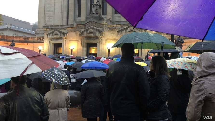 Capacity at 2,300 people was reached early for the interfaith vigil for 11 who were killed in Saturday's synagogue shootings. About 1,000 people stood in the rain and listened on loudspeakers on Oct. 28, 2018.