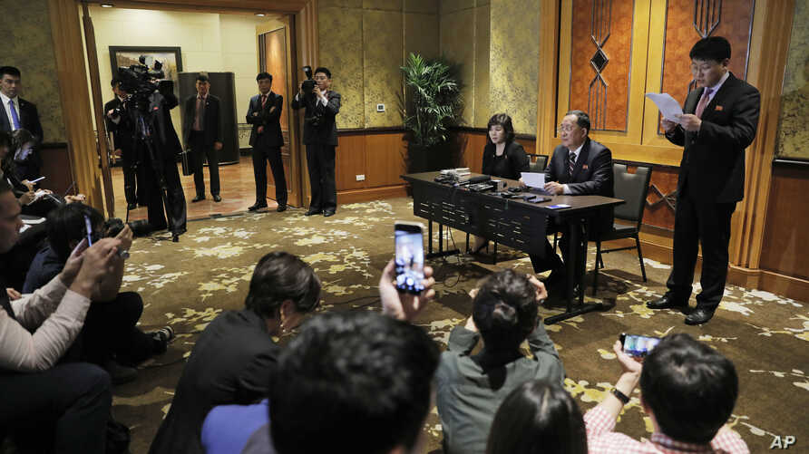 North Korea Foreign Minister Ri Yong Ho, second right, talks during a press conference at the Melia Hotel in Hanoi, Vietnam, Feb. 28, 2019. Talks between President Donald Trump and North Korea's Kim Jong Un collapsed Thursday after the two sides fail