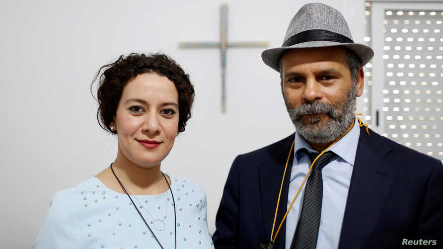 Farah Tarneem and her husband, Adam Rabti, a native Moroccan converted to Christianity, pose in a house used as a church in Ain Atiq district in the outskirts of Rabat, Morocco, June 4, 2018.