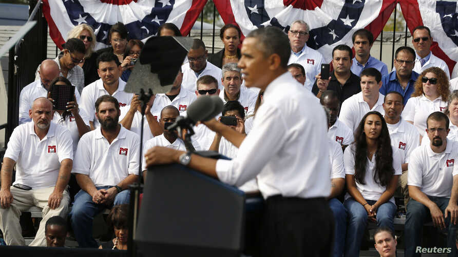 U.S. President Barack Obama delivers remarks on the government funding impasse at M. Luis Construction, a local small business in Rockville, Maryland, near Washington, October 3, 2013. Obama travelled to the business to highlight the impacts that a g