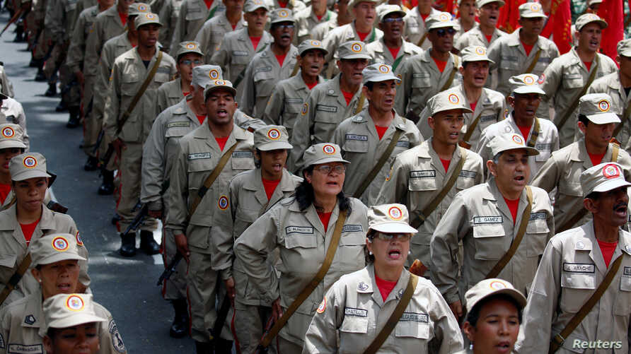Militia members stand at attention during a ceremony with Venezuela's President Nicolas Maduro at Miraflores Palace in Caracas, Venezuela, April 17, 2017.