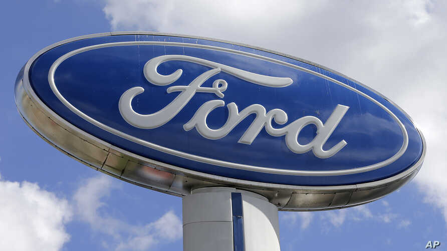 A Ford sign at an auto dealership in Hialeah, Florida, Jan. 17, 2017. Ford Motor Co. is investing $1.2 billion in three Michigan facilities, including an engine plant where it plans to add 130 jobs. President Donald Trump applauded the move in an ear