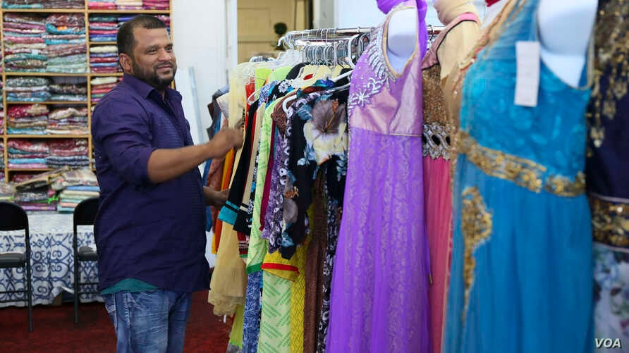 Bangladeshi-immigrant Shaker Sadeak moved to Michigan from New York in 2001 to seek greater economic opportunities. Today, he owns India Fashion fabric shop along Conant Street.