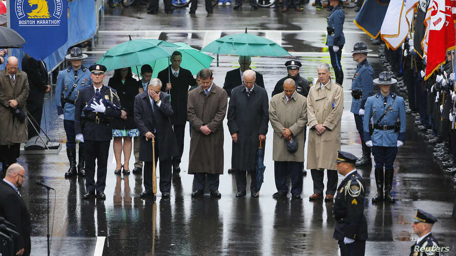 Former Boston Mayor Tom Menino (2nd L) during a moment of silence with current Boston Mayor Marty Walsh (3rd L), U.S. Vice President Joe Biden (C), Massachusetts Governor Deval Patrick (2nd R) and Boston Athletic Association Executive Director Tom Gr