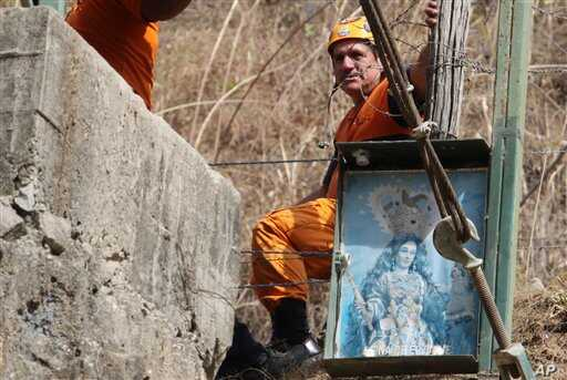 A rescue worker looks on outside the Minesadco mine in Portovelo, southern Ecuador, 16 Oct 2010