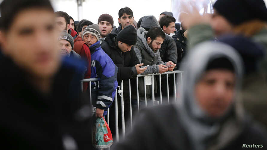 Migrants queue inside a tent at the compound outside the Berlin Office of Health and Social Affairs (LAGESO) waiting to register in Berlin, Germany, Dec. 1, 2015.
