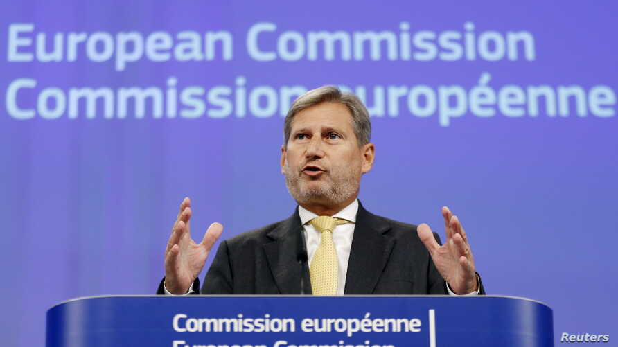 FILE - European Enlargement Negotiations Commissioner Johannes Hahn addresses a news conference at the EU Commission headquarters in Brussels, Belgium, Sept. 17, 2015.