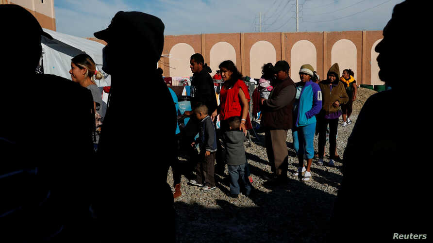 Migrants wait in line for food at a camp containing hundreds of migrants who arrived at the U.S. border from Central America in a caravan with the intention of applying for asylum in the U.S., in Tijuana, Mexico, Dec. 12, 2018.