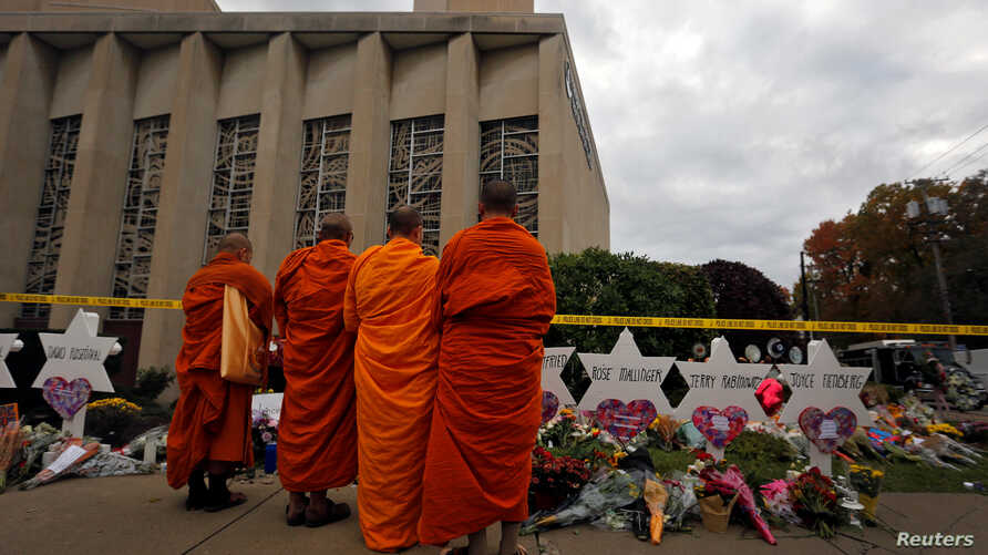 Monks pay their respects at a makeshift memorial outside the Tree of Life synagogue following Saturday's shooting at the synagogue in Pittsburgh, Penn., Oct. 29, 2018.