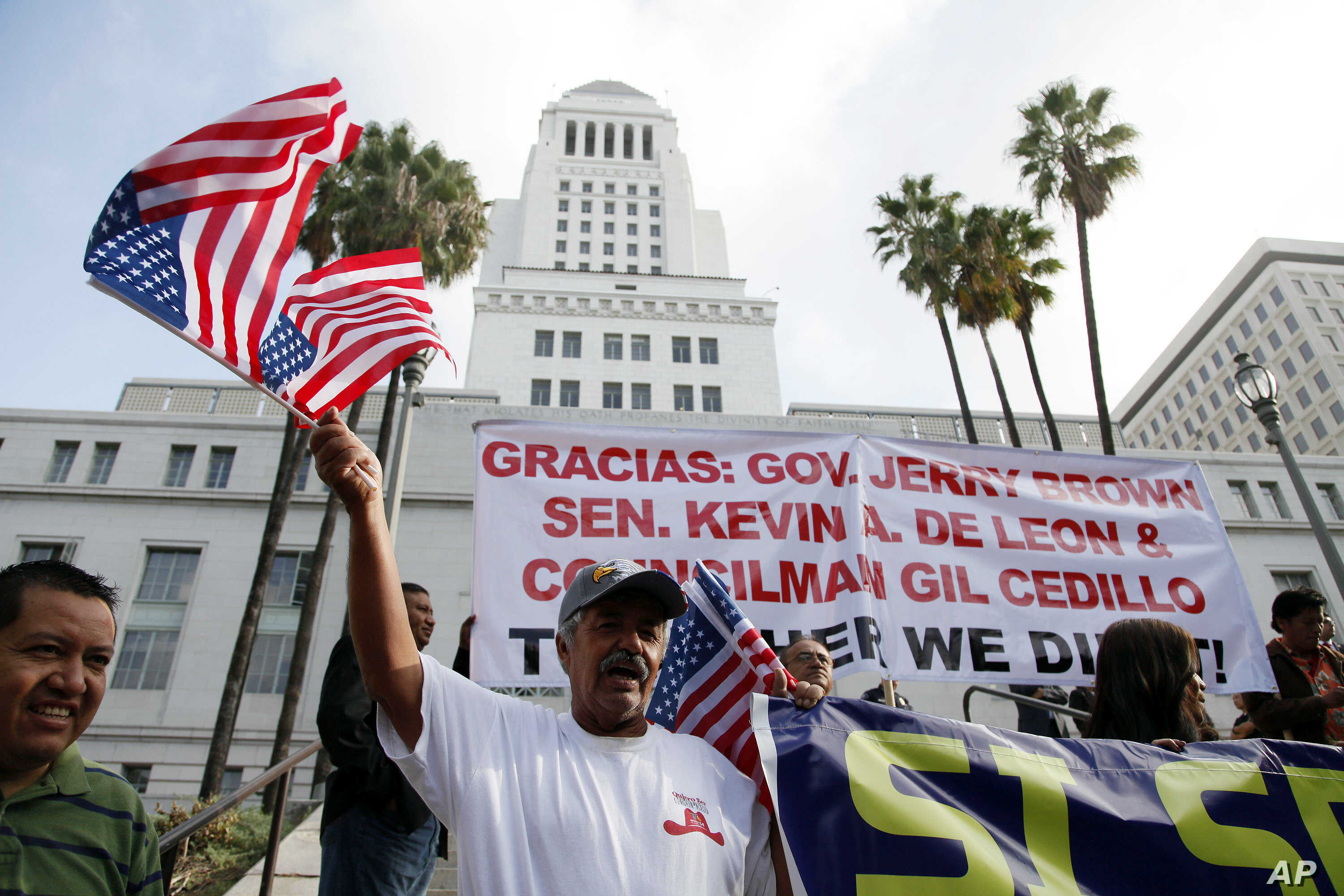 Ipolito Nurez celebrates outside City Hall after California Gov. Jerry Brown signed the bill AB 60, which allows immigrants in the country illegally to obtain driver licenses. Immigrant advocates have long lobbied for the change in the nation's most