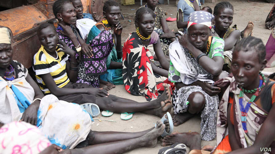 Women fear for their lives creeping back to Pibor town, but in the bush, people are starving. (Hannah McNeish for VOA)