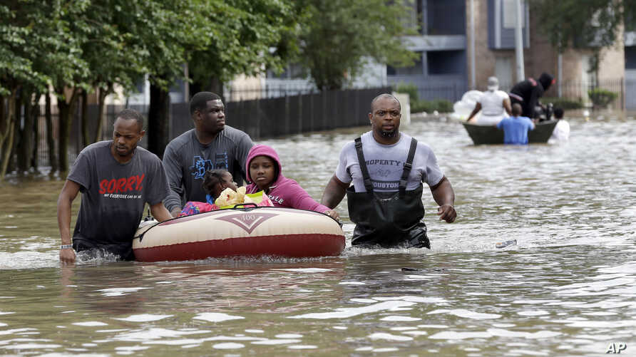 Residents are evacuated from their apartment complex surrounded by floodwaters in Houston, Texas, April 18, 2016.