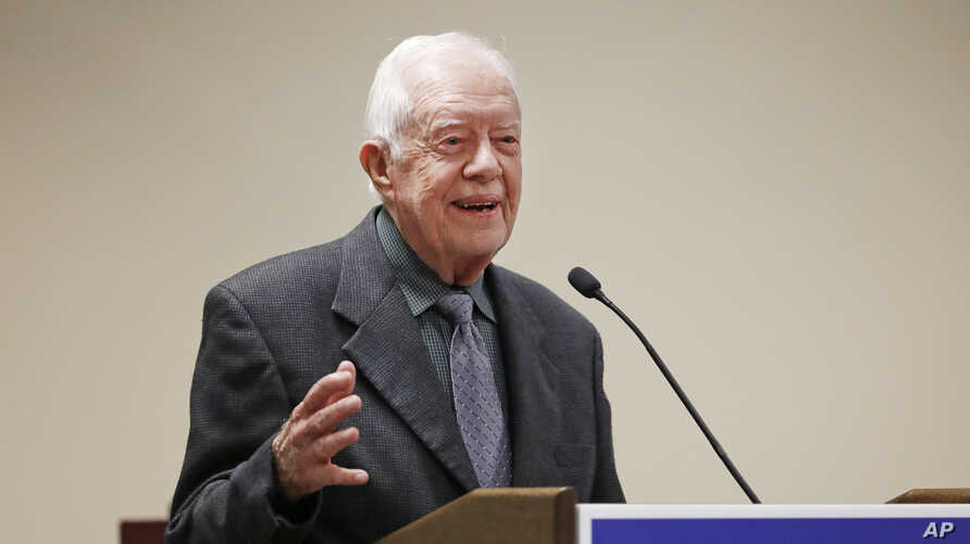 FILE - Former president Jimmy Carter speaks at a Baptist conference in Atlanta, Georgia, Sept. 15, 2016. On Wednesday, Carter unexpectedly defended President Donald Trump on immigration issues.