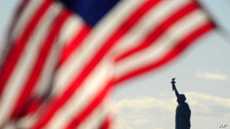 A US flag flutters above the Statue of Liberty in New York, which has become an iconic symbol of freedom and of the United States, (File)