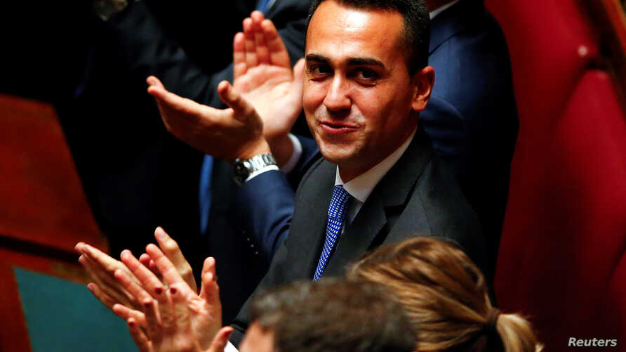 Five Star Movement leader Luigi Di Maio applauds the new Chamber of Deputies president Roberto Fico during the second session of parliament since the March 4 national election in Rome, Italy, March 24, 2018.