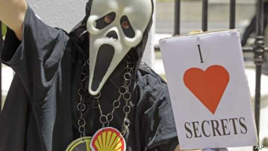 A protester holds a placard reading 'I Love Secrets' during a anti secrets bill protest at parliament in the city of Cape Town, South Africa, November 22, 2011.