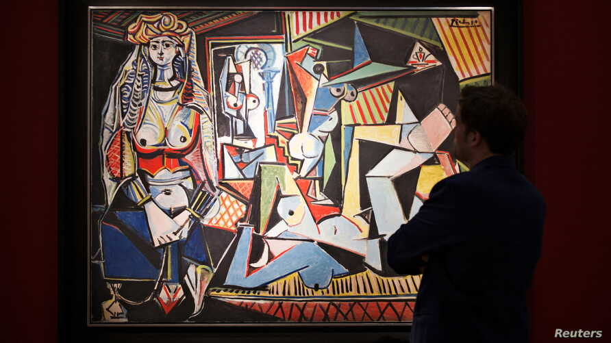 """A man pauses to look at Pablo Picasso's """"Les femmes d'Alger (Version 'O')"""" (Women of Algiers), estimated at $140 million, at a media preview for Christie's May 11 impressionist, modern and contemporary art sale in the Manhattan borough of New York, M"""