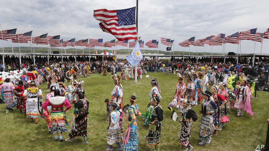 Native American dancers from more than 20 reservations in North and South Dakota perform before the arrival of President Barack Obama and first lady Michelle Obama on the Standing Rock Indian Reservation Friday, June 13, 2014, in Cannon Ball, N.D.