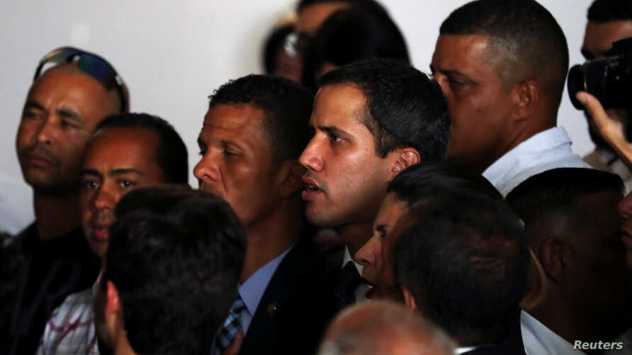 Venezuelan opposition leader Juan Guaido, whom many nations have recognized as the country's rightful interim ruler, sings the national anthem during a meeting regarding the condition of the water and electricity systems in Caracas, Venezuela, March