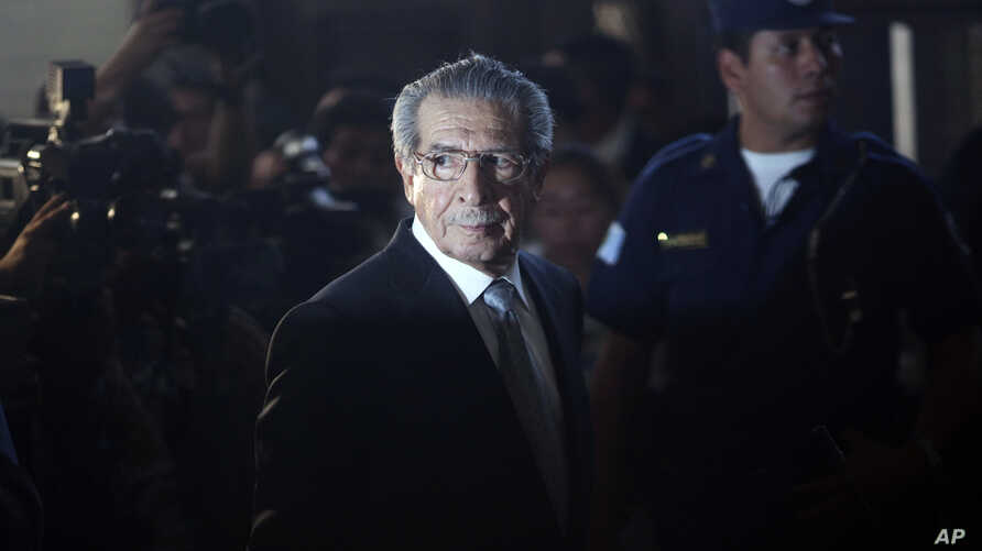 FILE - Guatemala's former dictator Efrain Rios Montt is seen returning from a break in court in Guatemala City, Jan. 26, 2012.