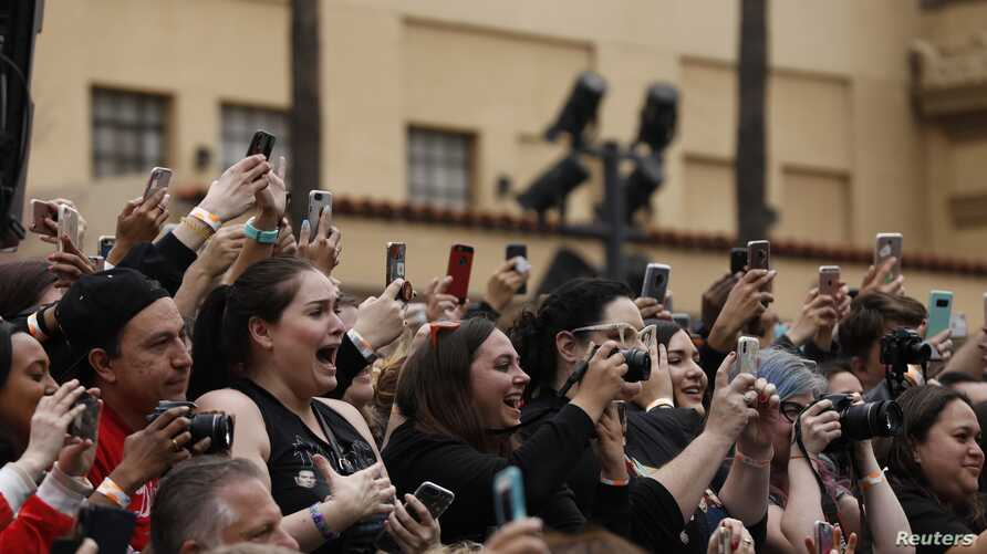 A fan reacts during the ceremony for the unveiling of the star for American boy band *NSYNC on the Hollywood Walk of Fame in Los Angeles, April 30, 2018.