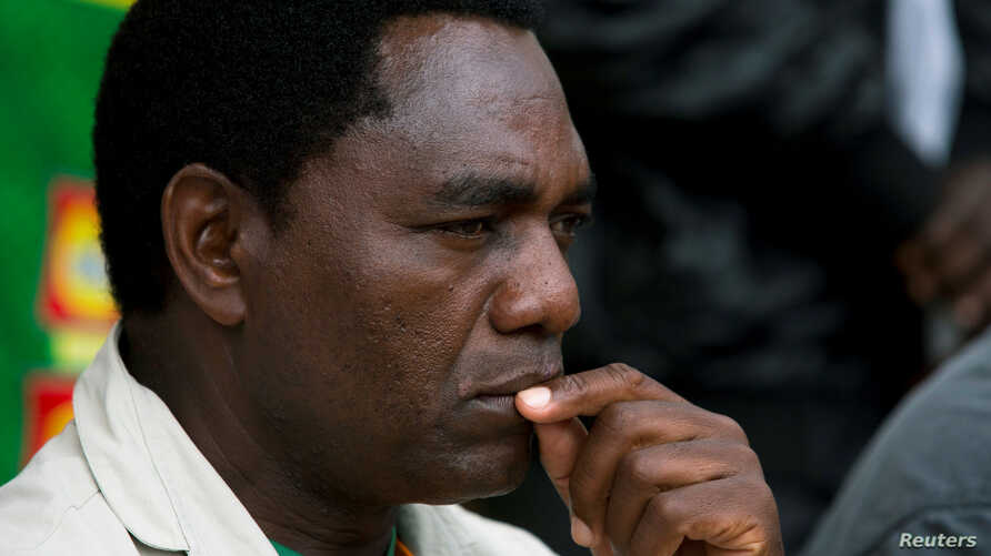 FILE - United Party for National Development (UPND) Presidential candidate Hakainde Hichilema looks on during a rally in Lusaka, Jan. 18, 2015