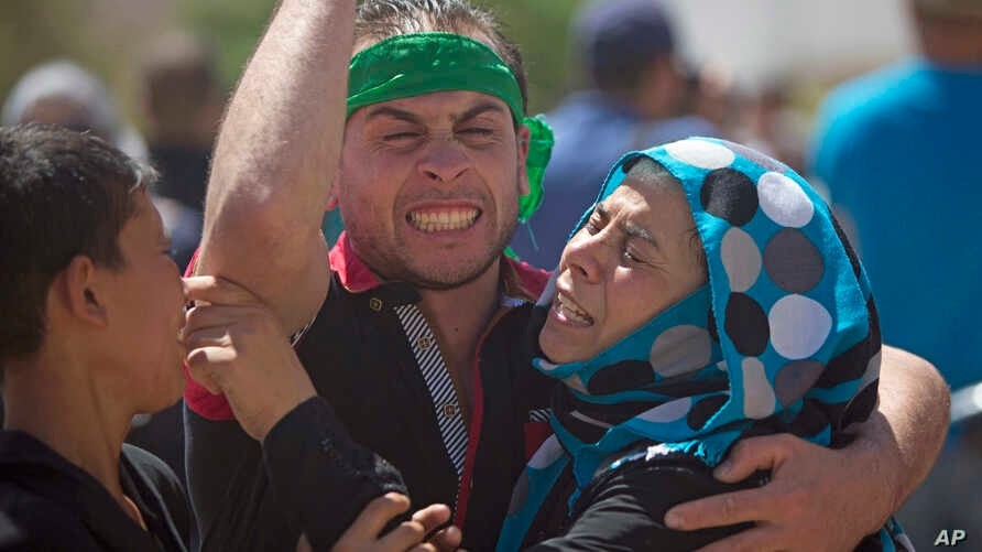 Palestinians mourn the death of Saed Dawabsheh, 32, during his funeral procession in the West Bank village of Duma near Nablus, Aug. 8, 2015.